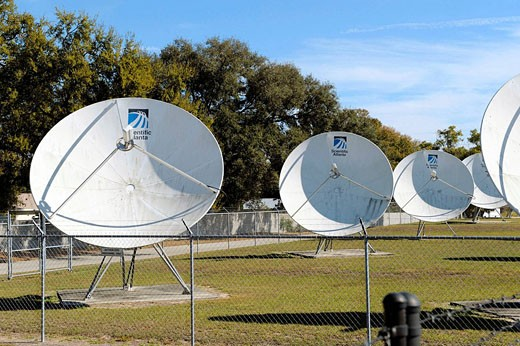 Satellite dishes transmit television signal to subscribers : Stock Photo