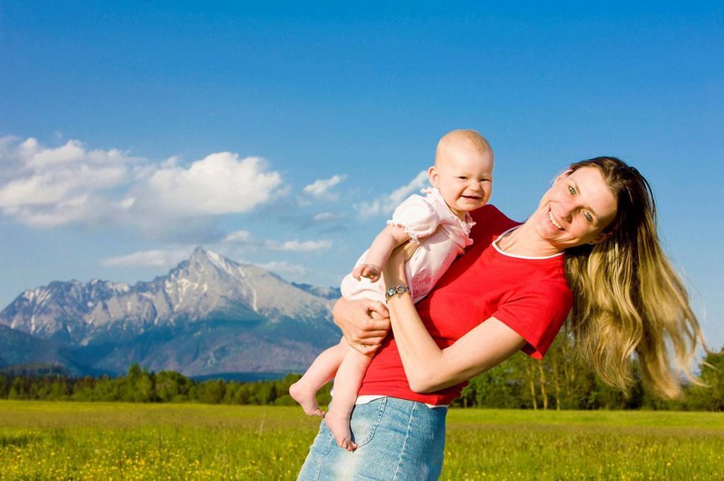 Stock Photo: 1566-517070 mother with her baby girl, Krivan, Vysoke Tatry High Tatras, Slovakia