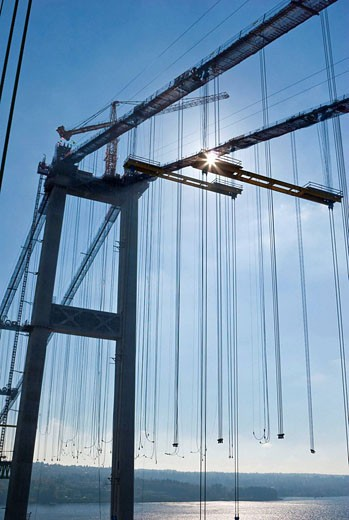 Crane on top of west tower of the new Tacoma Narrows Bridge during bridge construction : Stock Photo