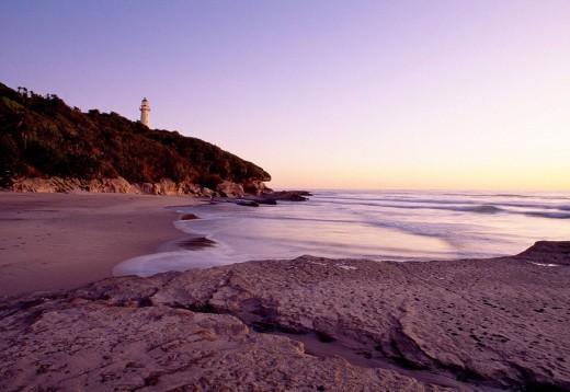 Stock Photo: 1566-519953 Kahurangi Point lighthouse at sunrise Kahurangi National Park New Zealand