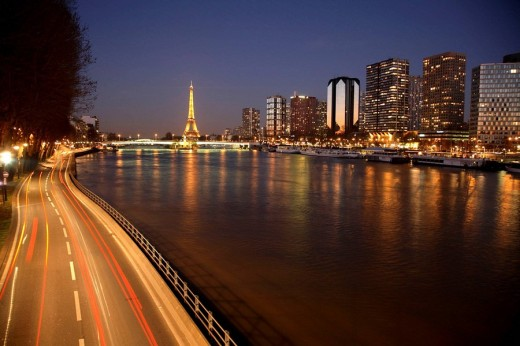 Night view of River Seine with high-rise buildings on the left bank and Eiffel Tower in background, Paris. France : Stock Photo