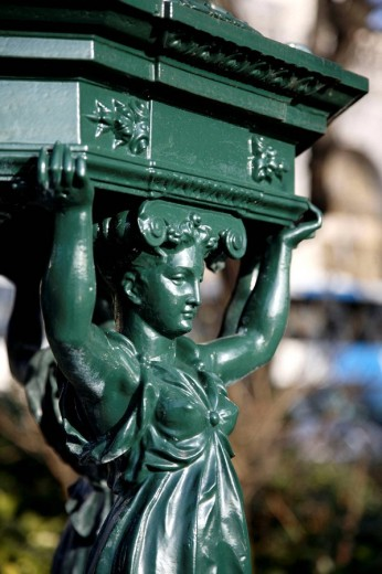 A closed up view of a figure on a drinking fountain in Montmartre, Paris. France : Stock Photo