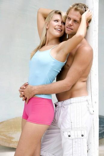 Stock Photo: 1566-521669 Man embracing a woman at home