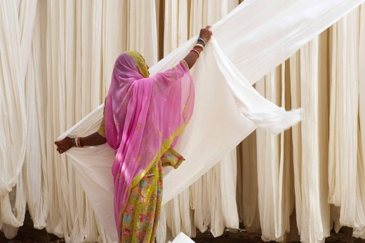 Folding fabric, sari manufacturing plant, Rajasthan, India : Stock Photo