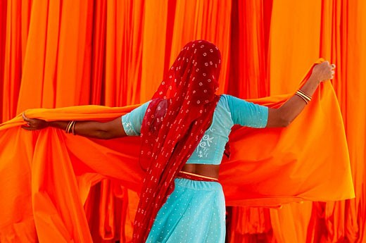 Stock Photo: 1566-521809 Getting fabric off the drying line, sari manufacturing plant, Rajasthan, India