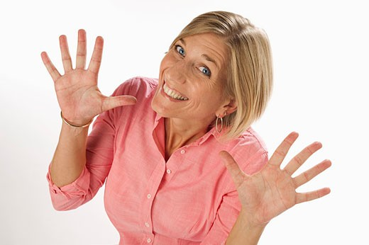Blonde girl shaking hands with happy expression. : Stock Photo