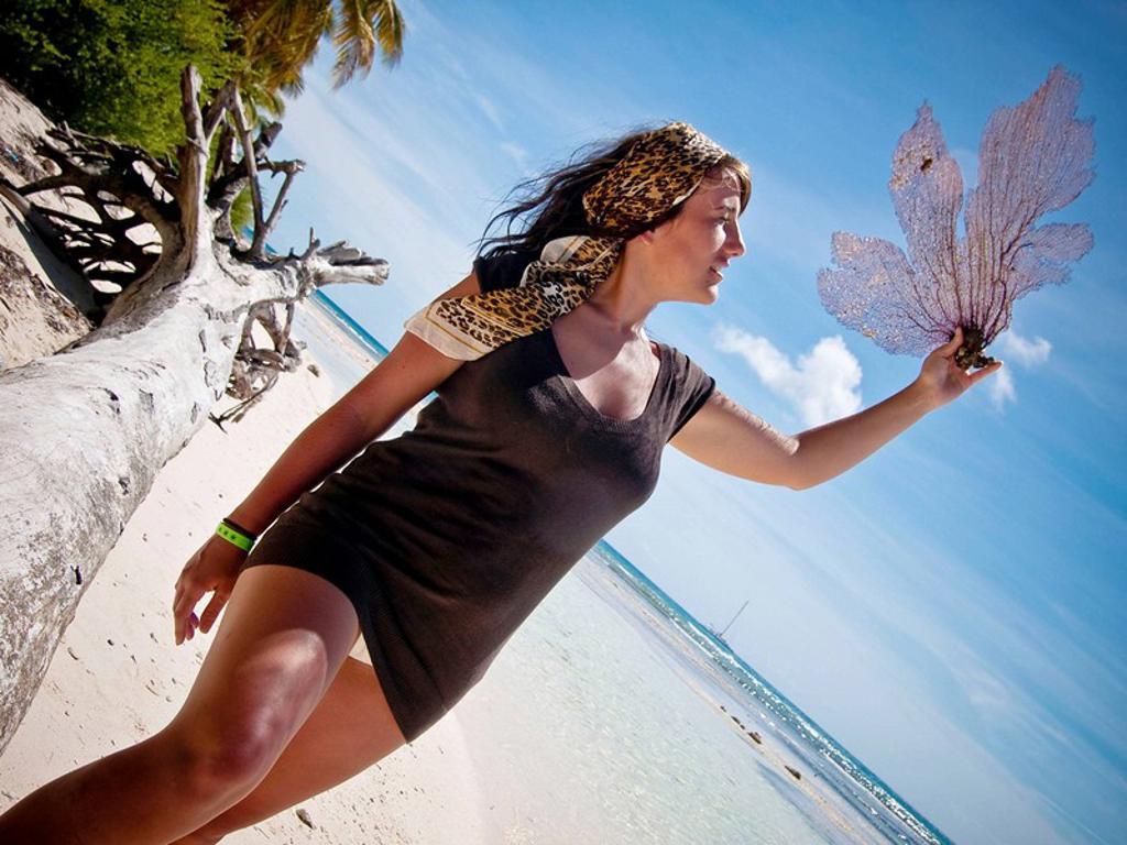 Stock Photo: 1566-528589 Woman on the beach, Saona Island , Dominican Republic