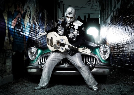 Stock Photo: 1566-529092 Silver Elvis with a guitar and a retro car in a graffiti painted street  Performing artist Peter Jarvis from Toronto Canada
