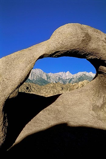 Mount Whitney seen through a granite Natural Arch, Alabama Hills, Sierra Nevada Mountains, Lone Pine, California, USA : Stock Photo