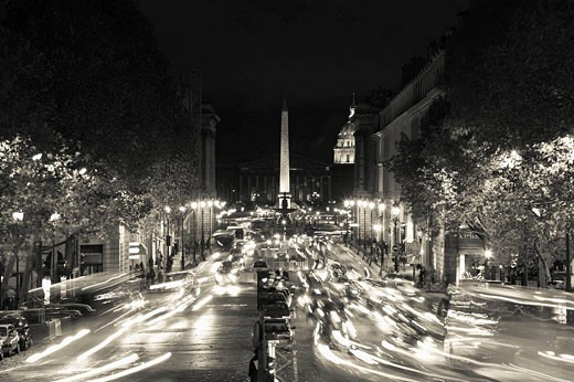 Traffic on Rue Royale from Sainte-Marie Madeleine church in the evening, Paris, France : Stock Photo