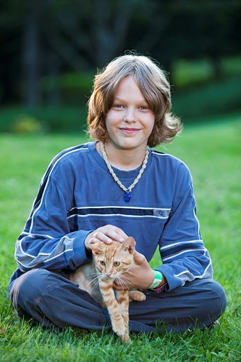 boy portrait with kitten : Stock Photo