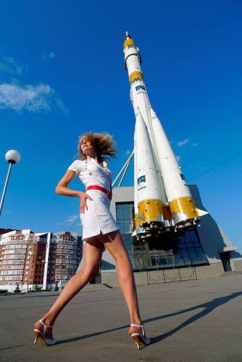 Woman front the Russian space transport rocket. A museum piece. Samara. Russia. : Stock Photo