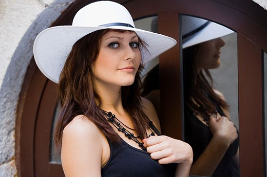 Stock Photo: 1566-531946 Young woman portrait with White hat