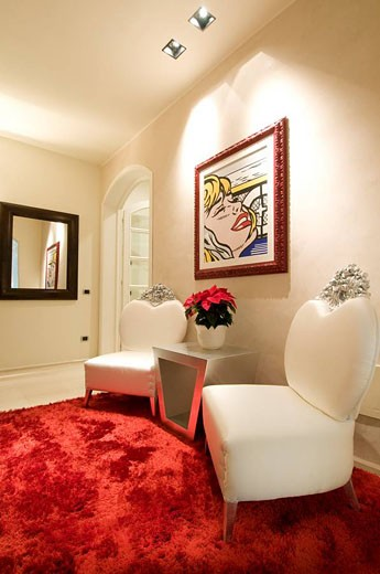 Home interior, corridor,with red carpet and white armchairs : Stock Photo