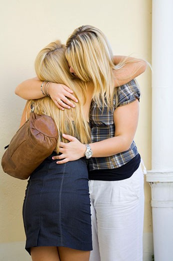 Stock Photo: 1566-533918 Two girls sorrow, hugging