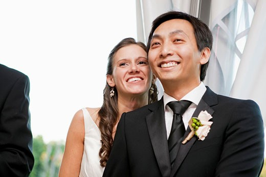 Stock Photo: 1566-534705 Bride and groom smiling