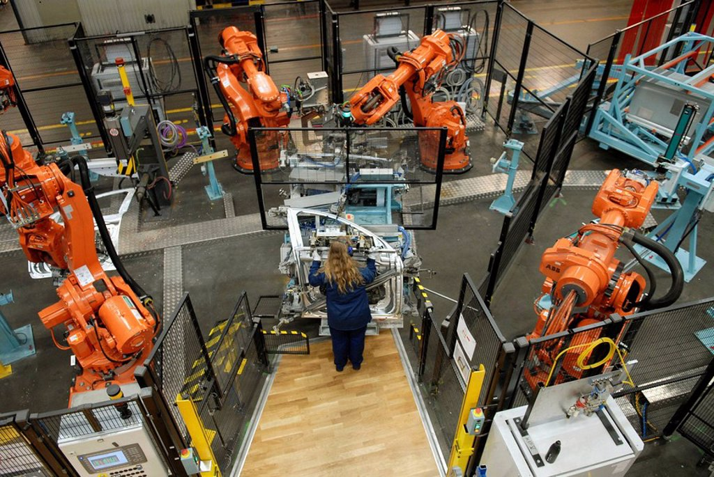 Stock Photo: 1566-538561 Operator, Volvo component factory and robot cells from ABB, car manufacturing, Olofström, Sweden