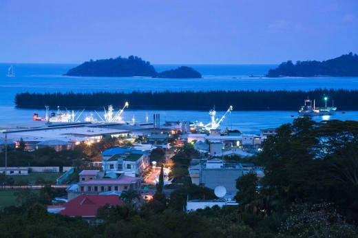 Town & harbor view from Beau Vallon Road at dusk, Victoria, Mahe island, Seychelles : Stock Photo