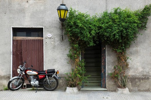 Stock Photo: 1566-539128 Doorway and motorbike, Colonia del Sacramento, Uruguay