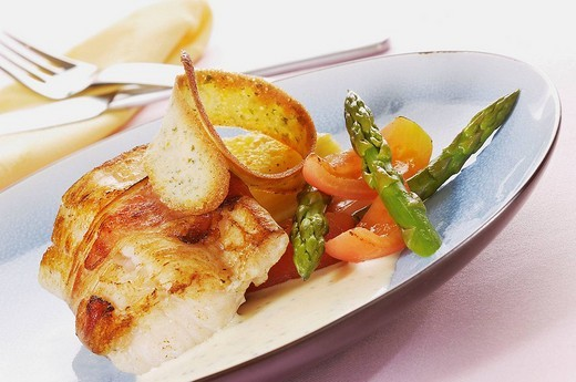Stock Photo: 1566-540320 Grilled fish with asparagus and tomotoe wedges, crouton, food