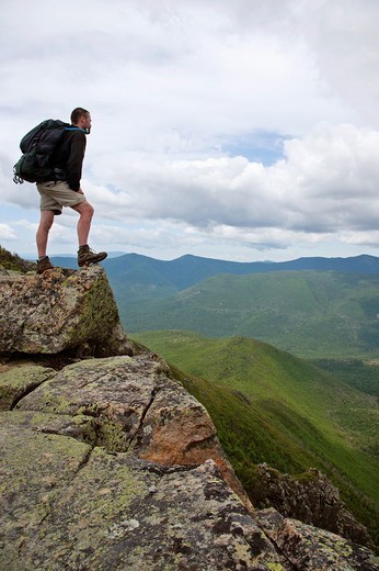 Stock Photo: 1566-547167 Pemigewasset Wilderness - A hiker on the summit of Bondcliff during the summer months  Located in the White Mountains, New Hampshire USA