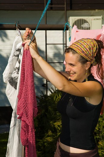 Stock Photo: 1566-547391 Woman hanging laundry Finland Europe