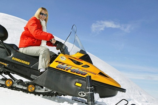 Stock Photo: 1566-548927 Woman on Ski Scooter in Winter Holiday