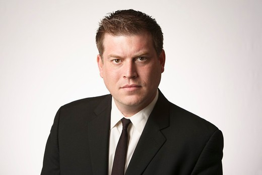 Serious midadult man wearing black suit and tie : Stock Photo