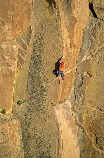 Stock Photo: 1566-550716 Greg Moore rock climbing a route called Strategic Defense which is rated 5,11 and located on Morning Glory Spire at The City Of Rocks National Reserve in southern Idaho USA