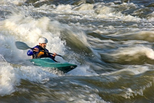 Stock Photo: 1566-550733 Dave Weber kayaking The Wave a rapid rated Class 4 on The Snake River near the town of Hagerman in southern Idaho USA