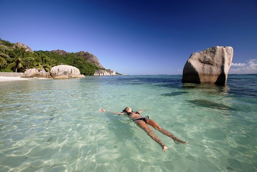Young woman relaxing at Anse Source D´Argent, La Digue Island, Seychelles : Stock Photo