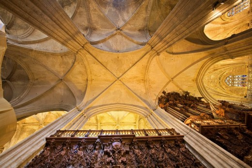 Gothic cross vault and organ on the right, cathedral of Seville. Andalusia, Spain : Stock Photo