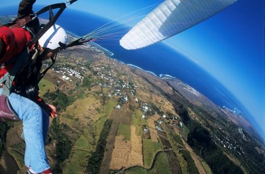 Stock Photo: 1566-554127 Aerial view of a paraglider pilot over sugar cane fields near Saint Leu. Reunion island (archipelago of Mascarenhas), French department island, Indian Ocean, Africa