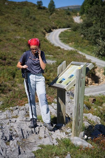 young woman outdoor with a cellphone  Los Collados del Ason Natural Park  Cantabria, Spain, Europe : Stock Photo