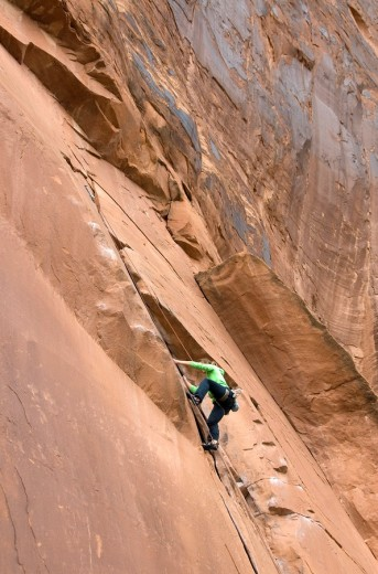 Young woman rock climbing off Utah Scenic Byway 279 near Moab, Utah, USA : Stock Photo