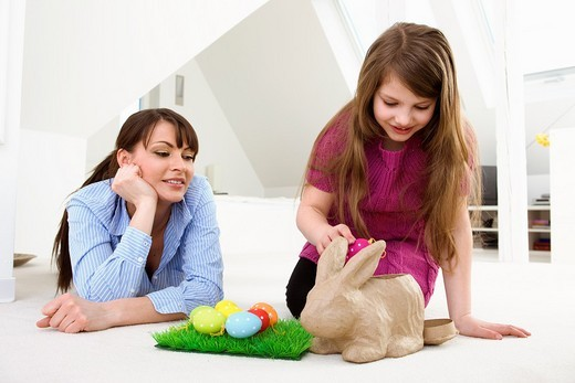 Mother and daughter with Easter eggs and rabbit. : Stock Photo