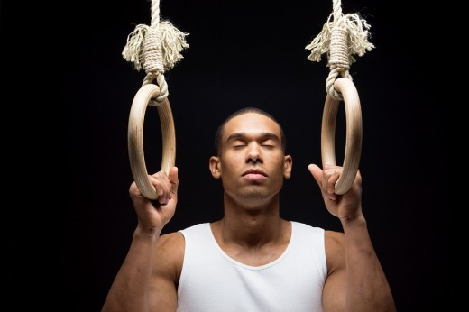 Gymnast man on Rings. : Stock Photo