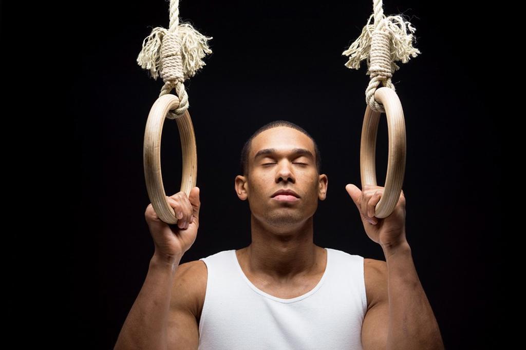 Stock Photo: 1566-556115 Gymnast man on Rings.