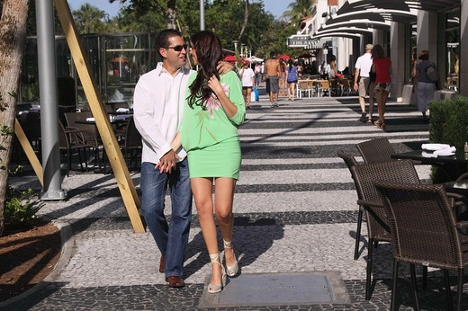 Couple walking in lincoln road Miami Beach : Stock Photo