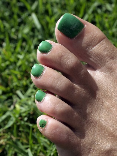 Stock Photo: 1566-559738 Nail polish makeup woman green