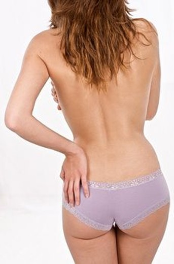Stock Photo: 1566-560147 Young attractive woman in underwear, seen from the back