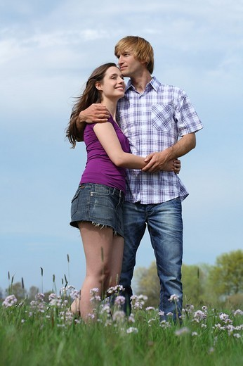 Young couple walking in summer landscape : Stock Photo