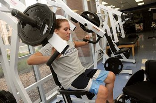 Stock Photo: 1566-560196 UA student Jennifer Poist works out at the campus Disability Resource Center  Poist is on the university´s wheelchair basketball team