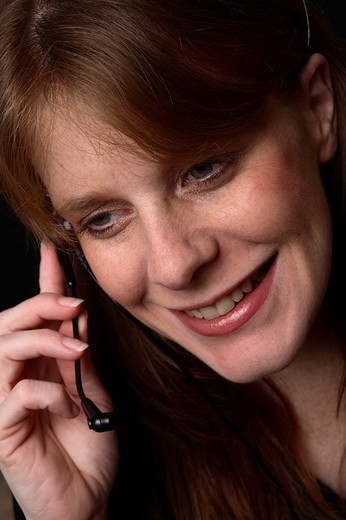 Woman wearing telephone headset : Stock Photo
