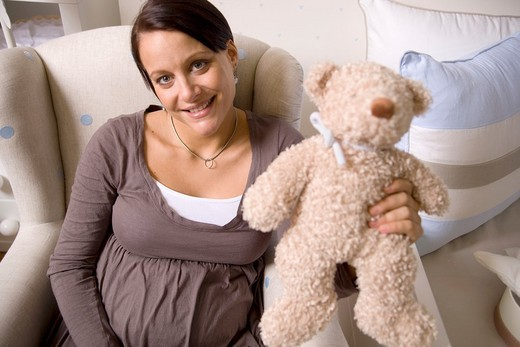 Stock Photo: 1566-562132 Pregnant women with Stuffed Animals.