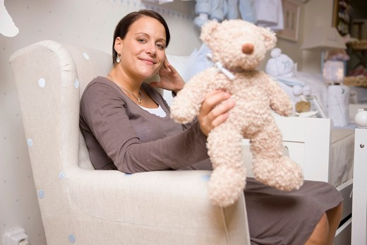 Pregnant women with Stuffed Animals. : Stock Photo