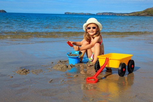 Stock Photo: 1566-564315 girl playing on sandy beach, Sutherland, Scotland