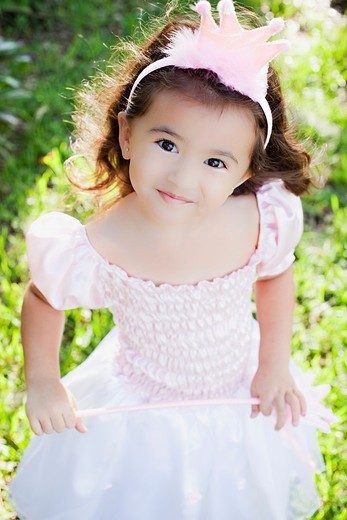 Little girl playing dress up as a princess. : Stock Photo