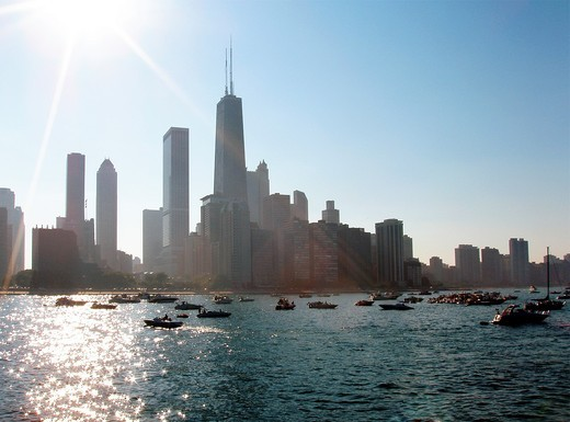 Stock Photo: 1566-566083 Summertime view of the Chicago Skyline with boats moored in Lake Michigan