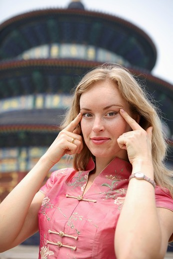 Stock Photo: 1566-566362 Woman joking in the Temple of Heaven. Beijing. China.
